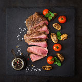 Juicy steak medium rare beef with spices Stock Photo