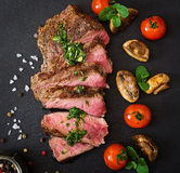 Juicy steak medium rare beef with spices Stock Image