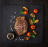 Juicy steak medium rare beef with spices Royalty Free Stock Images