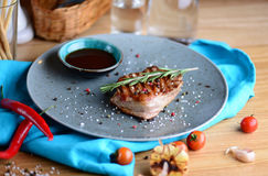 Juicy steak on an plate with sauce served for a dinner in a steakhouse. Food background. Close up stock images