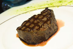 Juicy steak on a plate. Juicy steak served on a plate Royalty Free Stock Photos