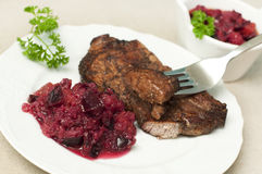 Juicy steak with plum relish Stock Photography