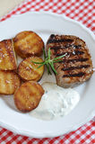 juicy steak with potato wedges Stock Photos