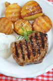Juicy steak with potato wedges Royalty Free Stock Images