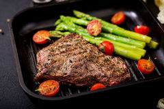 Juicy steak rare beef with spices Royalty Free Stock Photos