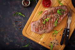Juicy steak rare beef with spices Stock Images