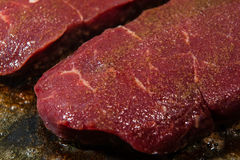 A juicy steak seasoned with pepper ready to be fried Stock Image