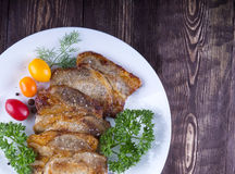 Juicy steak with spices and vegetables . Juicy portions of grill Royalty Free Stock Photos