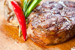 Juicy steak with vegetables Stock Photos