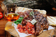 Juicy steak on the wooden background Stock Photos