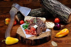 Juicy steak on the wooden background Stock Image