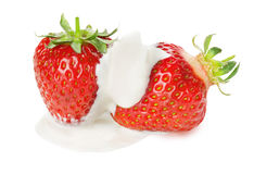 Juicy strawberries in cream on the white background Stock Image