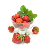 Juicy strawberries in a glass bowl isolated on white background Stock Photo