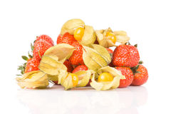 Juicy strawberries with golden physalis on white background. Stock Photo