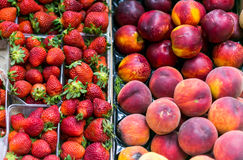 Juicy strawberries and nectarines lie on the counter Stock Photo