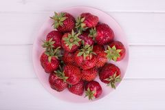 Juicy strawberries on a plate. Fresh berries from the garden. Summer healthy lunch stock photo