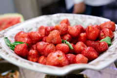 Juicy strawberries on a plate. Of served table Royalty Free Stock Images