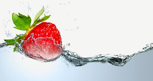 Juicy strawberries in a spray of water. Royalty Free Stock Photos