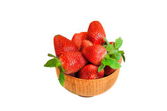 Juicy  strawberries in wooden bowl  isolated on white background Royalty Free Stock Image