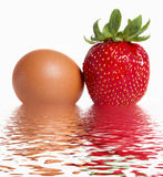 Juicy strawberry and egg. Stock Photo