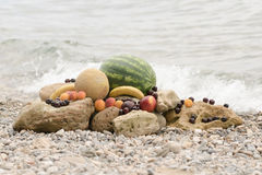 Juicy summer fruits against the blue sea. Royalty Free Stock Photography