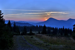 Juicy sunrise in forest and mountainous areas. The juicy sunrise in forest and mountainous areas Stock Photo