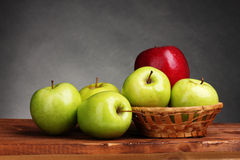 Juicy sweet apples in basket Stock Photography