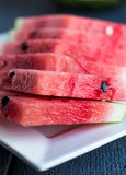 Juicy, sweet slices of watermelon, summer berry. Juicy, sweet slices of watermelon  on a dark wooden background Stock Photography