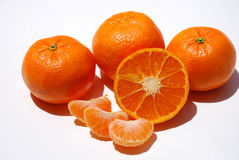 Juicy Tangerines. Delicious and juicy orange tangerines grouped together and isolated on white Stock Photography