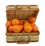 Juicy tangerines in the wicker box over white Royalty Free Stock Photography