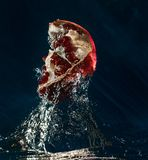 Juicy taste of the pomegranate. stock images