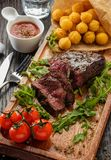 Juicy tasty grilled fillet steak served with tomatoes and cheese Stock Images