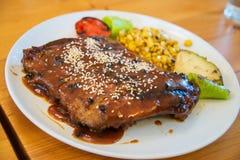 Juicy and tasty grilled pork steak Stock Image