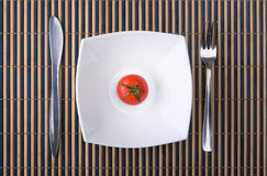 Juicy tomato in plate. Diet food Stock Images
