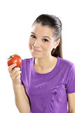 Juicy tomato. Woman takes a bite of a tomato Royalty Free Stock Images