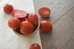 Juicy tomatoes in a bowl Stock Photo