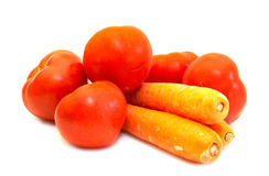 Juicy tomatoes with carrot close-up. (isolated Royalty Free Stock Photos