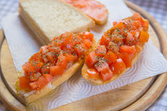 Juicy Tomatoes on Crusty Bread Stock Photography