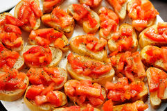 Juicy tomatoes on fresh bread Stock Photo