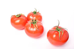 Juicy tomatoes on white background. Cherry tomatoes on a white background Royalty Free Stock Photography