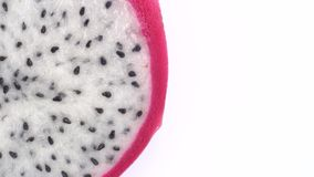 Juicy tropical dragon fruit rotates. Close-up of pitahaya on white background. 4K stock video footage