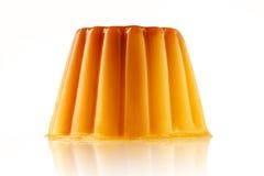 Juicy udding or creme caramel isolated over white background royalty free stock photo