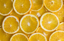 Juicy vibrant yellow orange slices closeup backing. Vibrant yellow orange slices closeup backing Royalty Free Stock Images