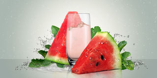 Juicy watermelon with a glass of watermelon juice. Royalty Free Stock Images