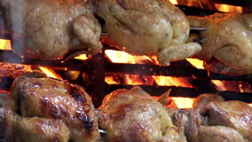 Juicy whole roasted chickens on flames. Juicy whole roasted chicken that is very good for special occasions. This is very common in Asian countries stock footage