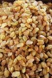 Juicy yellow dried raisins. A lot of appetizing yellow raisins, pattern, dried grapes Royalty Free Stock Photos