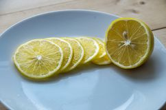 Juicy yellow lemon on a plate royalty free stock image