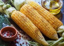 Juicy young corn ready for baking with olive oil and spices Royalty Free Stock Image