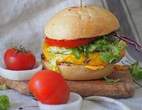 Juicy and yummy hamburger. Royalty Free Stock Images
