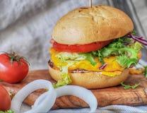 Juicy and yummy hamburger. Stock Photo